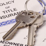 keys to house with home ownership documents